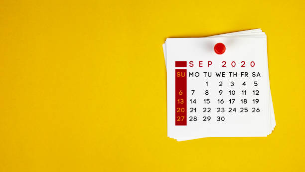 Post It September 2020 Calendar On Yellow Background stock photo