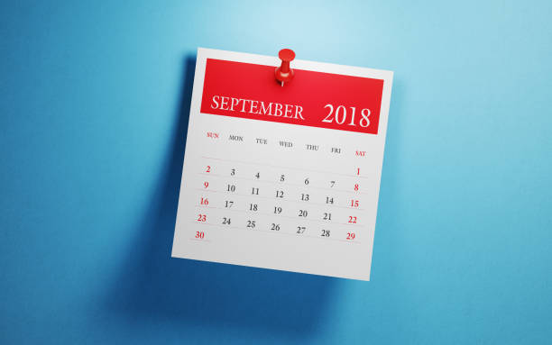 post it september calendar on blue background - september stock photos and pictures