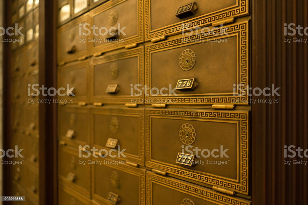Post Office Box Keyed Mailbox Ornate Apartment Lobby stock photo