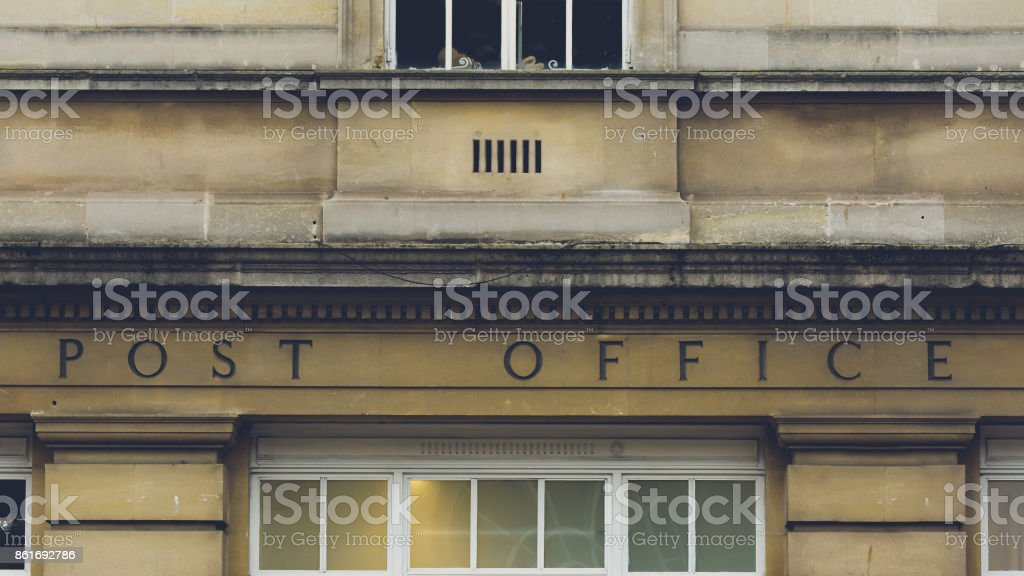 Post Office Carved in the Stone stock photo