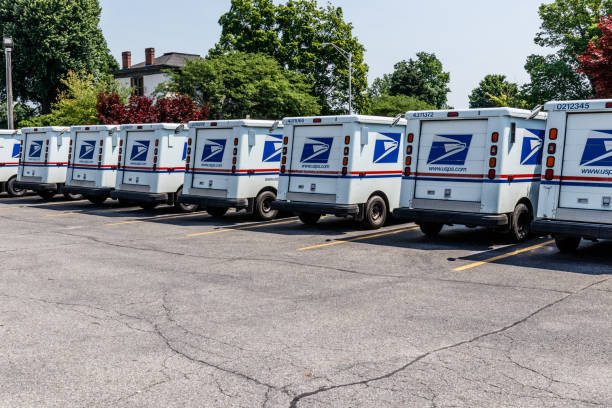 USPS Post Office Mail Trucks. The Post Office is Responsible for Providing Mail Delivery III Logansport - Circa June 2018: USPS Post Office Mail Trucks. The Post Office is Responsible for Providing Mail Delivery III apothegm stock pictures, royalty-free photos & images