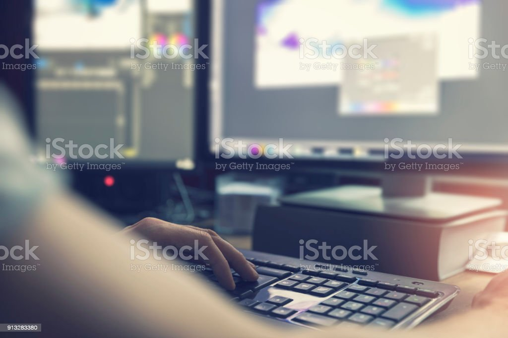 post production - man doing photo and video editing on computer stock photo