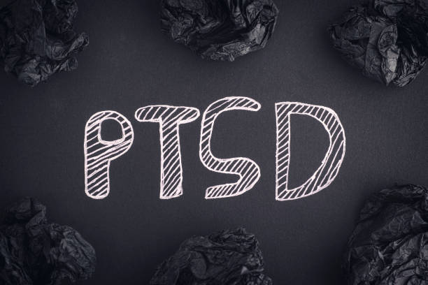 Post Traumatic Stress Disorder Post Traumatic Stress Disorder. Abbreviation PTSD on a black background and black crumpled paper balls around it. Close up. post traumatic stress disorder stock pictures, royalty-free photos & images