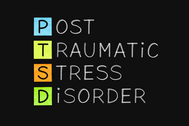 Post Traumatic Stress Disorder PTSD PTSD acronym Post Traumatic Stress Disorder handwritten with white chalk on blackboard. post traumatic stress disorder stock pictures, royalty-free photos & images