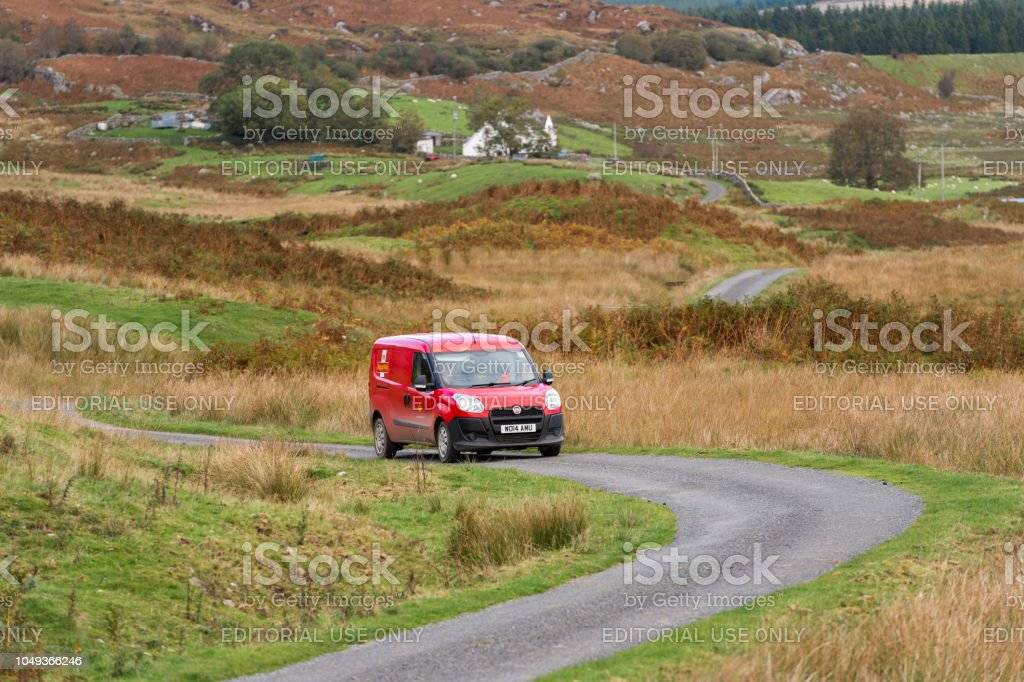 Post van on a rural road in Dumfries and Galloway south west Scotland stock photo
