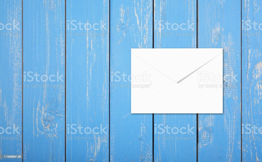 Postage and packing service - Top view Envelope on a blue wood plank...