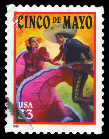 USA postage stamp showing an image of Mexican Flamenco dancers celebrating Cinco De Mayo Mexico independence