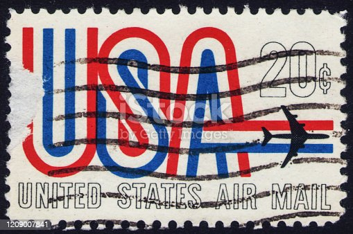 Stamp issued in the United States with the inscription USA and the image of a jet plane