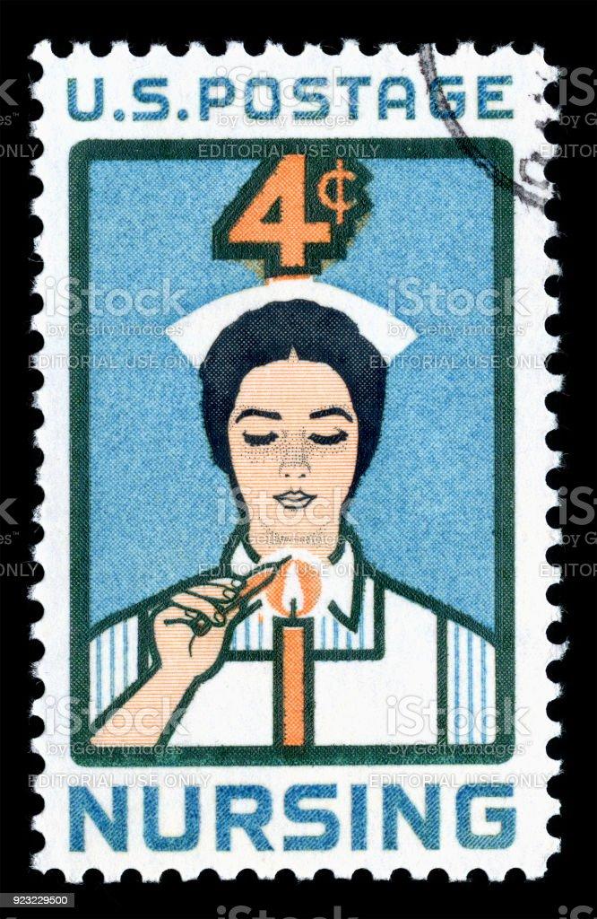 USA Postage Stamp Nurse lighting Candle of Dedication stock photo