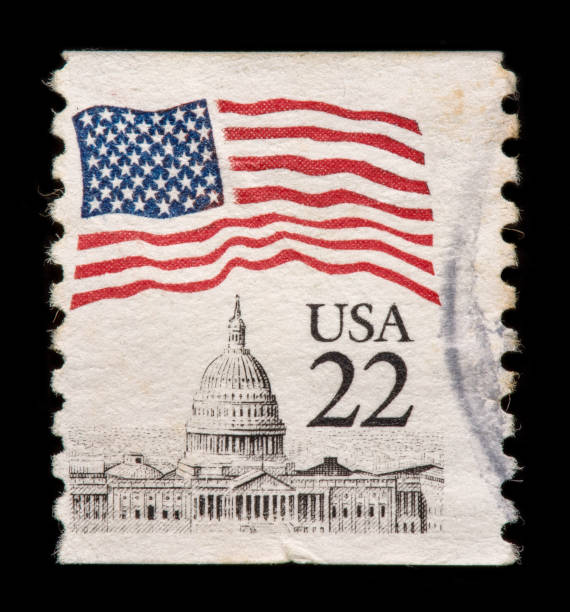 US Postage Stamp Stamp US Flag Over State Capitol building with black background. stamp stock pictures, royalty-free photos & images