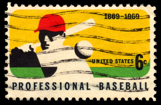 USA vintage postage stamp with an image of a professional baseball player striking a ball