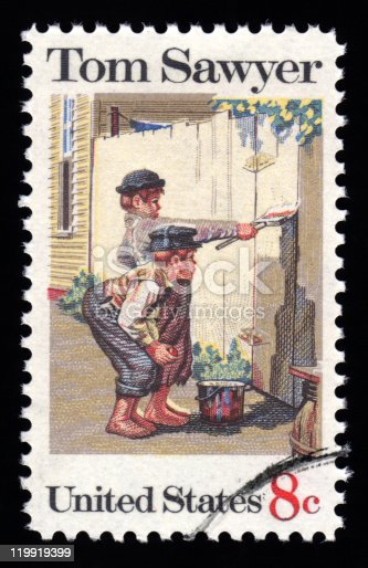 USA vintage postage stamp showing an image of two boys painting a fence from Mark Twain's novel Tom Sawyer