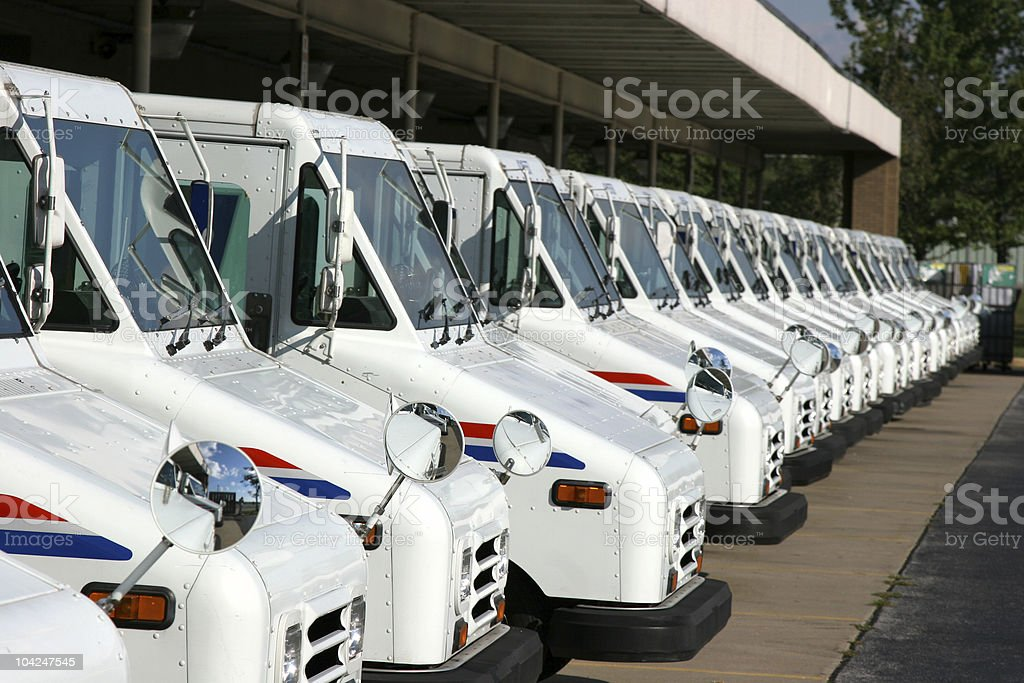Postal delivery trucks stock photo