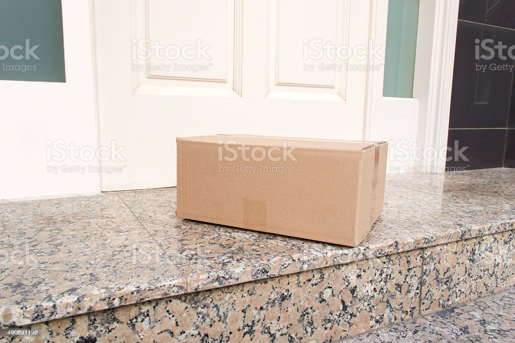 postal packet delivered stock photo