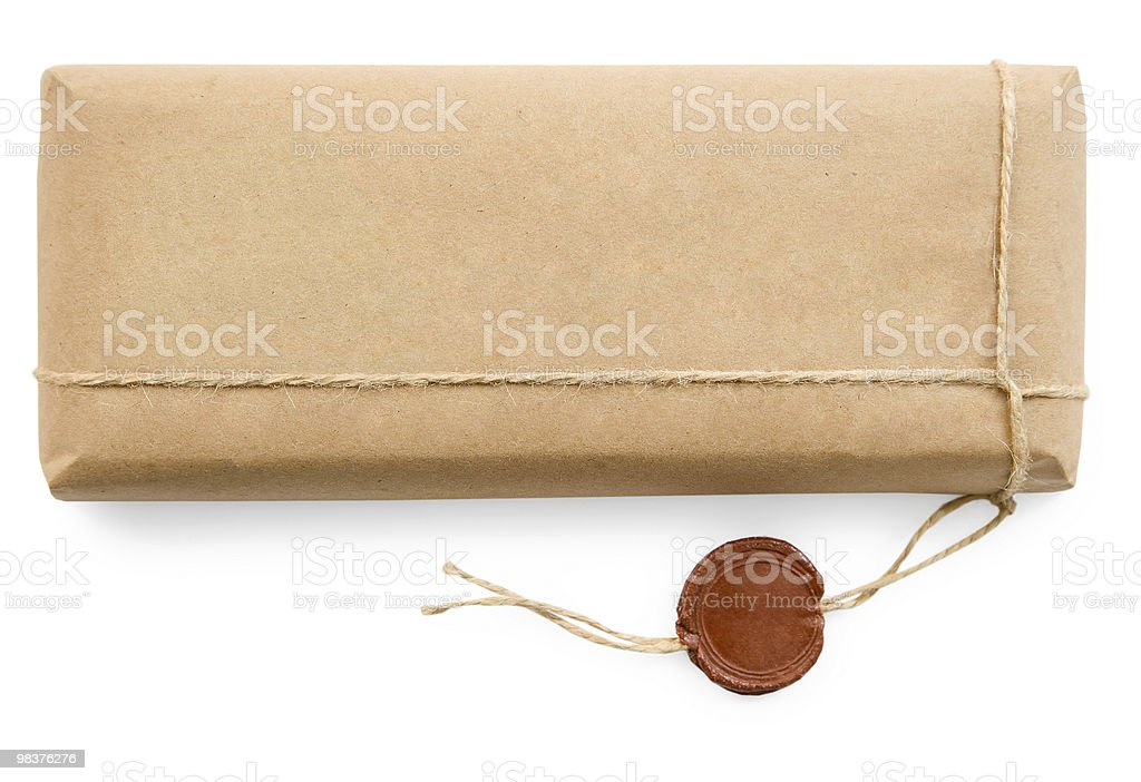 Postal parcel in coarse paper on white background royalty-free stock photo
