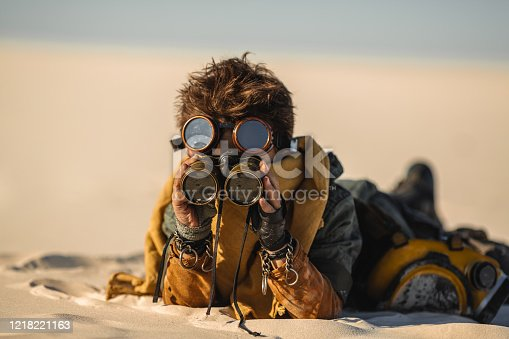 istock Post-apocalyptic Warrior Boy Outdoors in a Wasteland 1218221163
