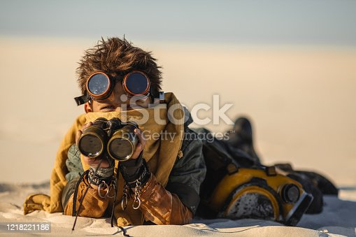 istock Post-apocalyptic Warrior Boy Outdoors in a Wasteland 1218221186