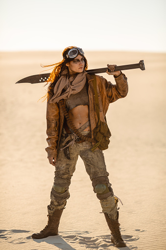 istock Post-apocalyptic Woman Outdoors in a Wasteland 1262860654