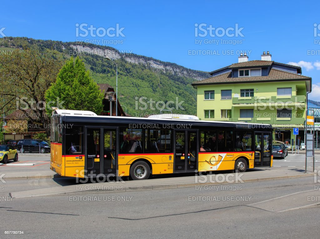 PostAuto bus in the town of Stans, Switzerland stock photo