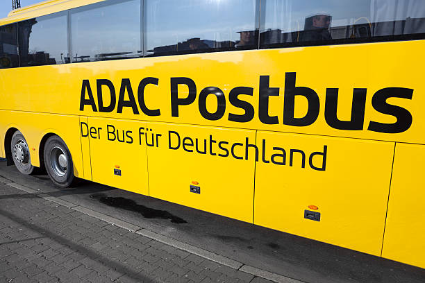 ADAC Postbus Frankfurt, Germany - January 30, 2014: Sideview of ADAC Postbus in the city center of Frankfurt, some passengers behind the windows. ADAC Postbus is an Intercity bus service of Deutsche Post Mobility and German automobile association ADAC. It operates after the deregulation of the German Fernbusverkehr (intercity bus connections) various routes through Germany. deregulation stock pictures, royalty-free photos & images