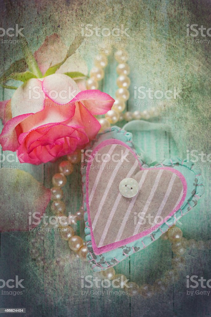 Postcard with decorative heart and fresh flower stock photo