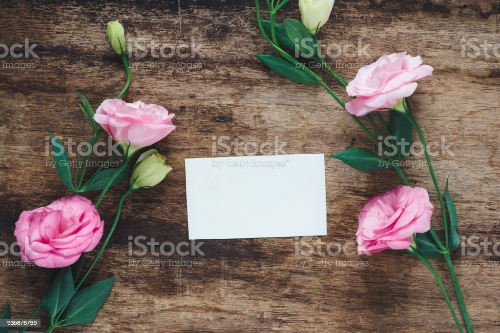 Postcard with fresh flowers and empty tag for your text. stock photo