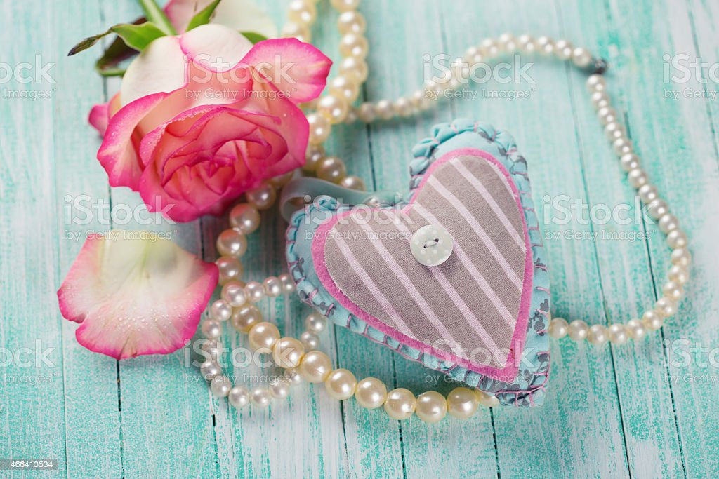 Postcard with heart and elegant  flower stock photo