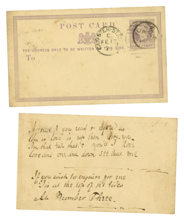"""A very old, faded, love message on a postcard, dated 1871, and bearing a stamp of Queen Victoria. The message is written as a puzzle, reading up and down, and says: """"I am in love, and that is true, I love but one, and that is you, read up & down & then you'll see, that I love you, do you love me?"""" It was sent to a young man and has obscure directions on how to find the sender."""