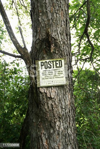 Posted - No Trespassing Sign nailed to a tree