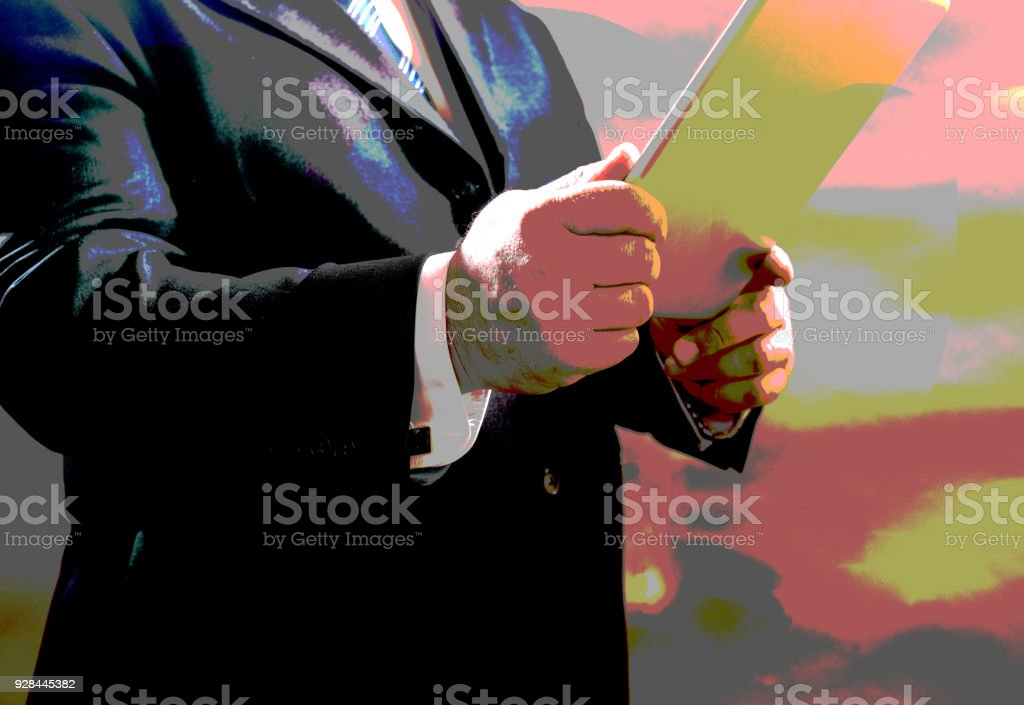 poster effect, businessman standing in suit and use your tablet, isolated on a gray background. stock photo