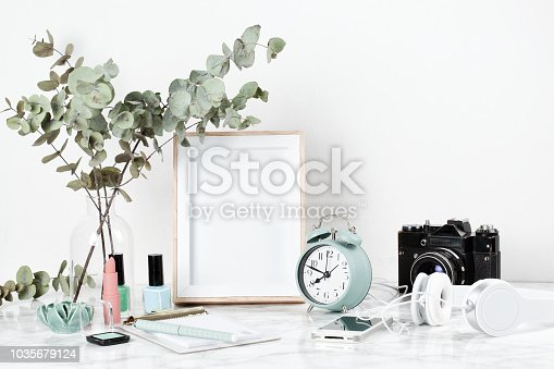 1208254898 istock photo Poster frame mockup, front view, with decor element 1035679124