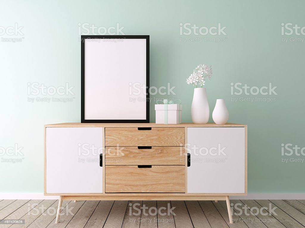 poster mockup on blue wall stock photo