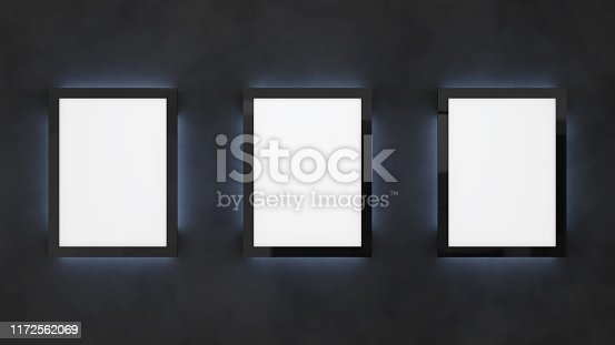 istock Poster mockup on the black wall with backlight. Cinema lightbox template. 1172562069