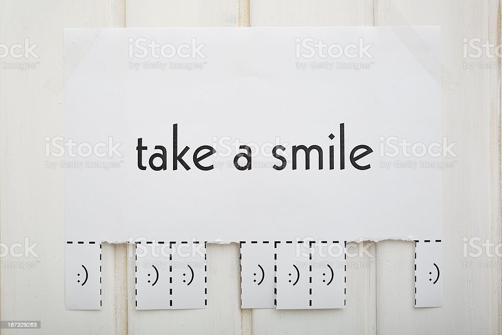 Poster of an Advertise 'Take a Smile' to Tear off royalty-free stock photo