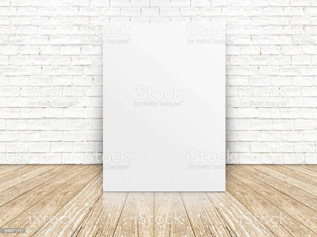 poster on the white brick wall and the wood floor stock photo