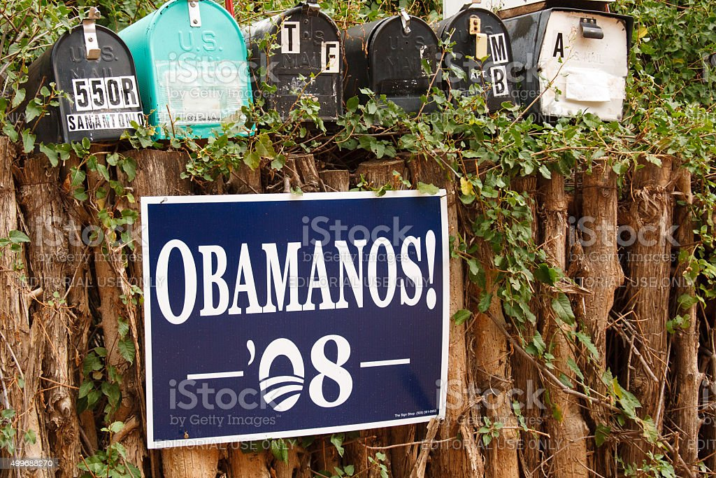 'OBAMANOS!' Poster on Traditional Coyote Fence, Santa Fe, NM stock photo