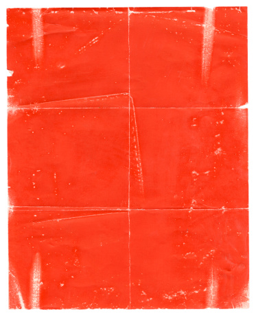 Red poster paper background, shows plenty of wear and tear.