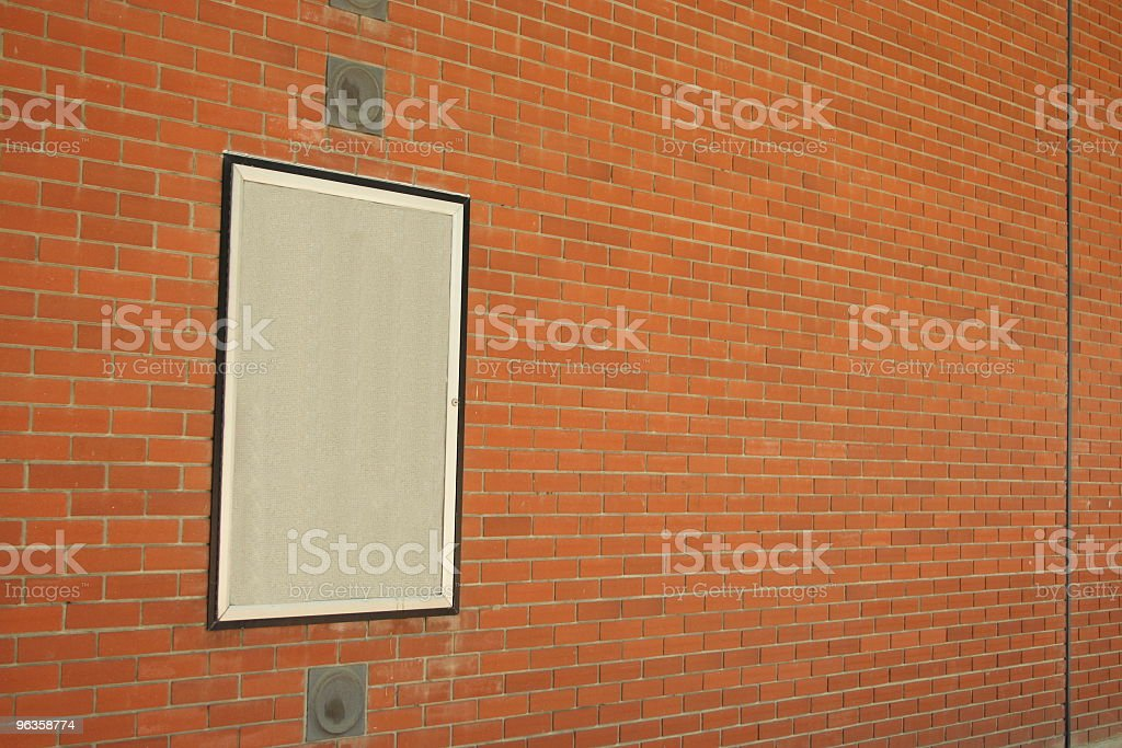 poster spot on brick wall - horizontal royalty-free stock photo
