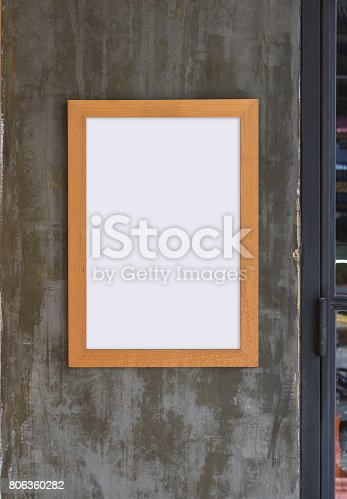532332971 istock photo Poster Template with wood frame on gray grunge wall background 806360282