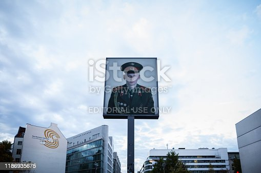 Berlin, Germany 18 October 2019: Poster of russian soldier at Checkpoint Charlie in Berlin, Germany.