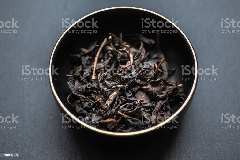 Post-fermented Japanese tea in a black dish - Royalty-free Brown Stock Photo
