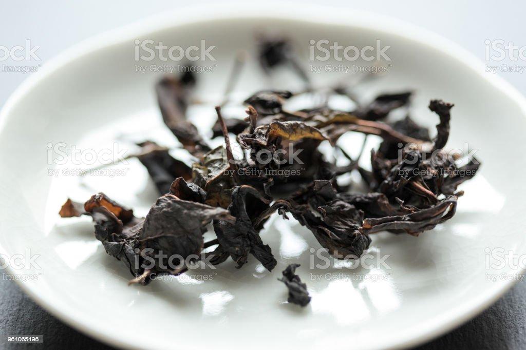 後発酵させたお茶の茎し、葉 - 人物なしのロイヤリティフリーストックフォト