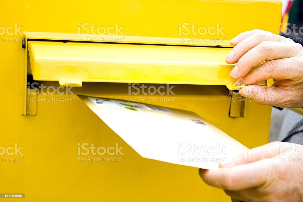 Posting letter at mailbox stock photo