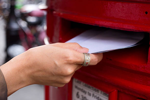 posting letters a hand posting letters sending stock pictures, royalty-free photos & images