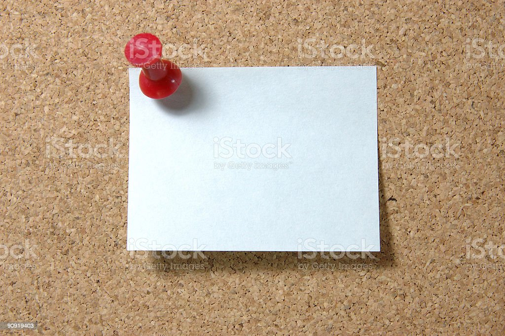 Post-it note with pushpin on corkboard royalty-free stock photo