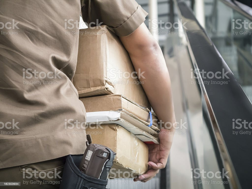 Postman carrying parcels stock photo