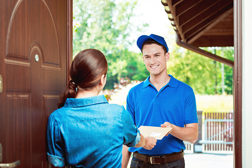 Postman Delivering A Mail Stock Photo - Download Image Now
