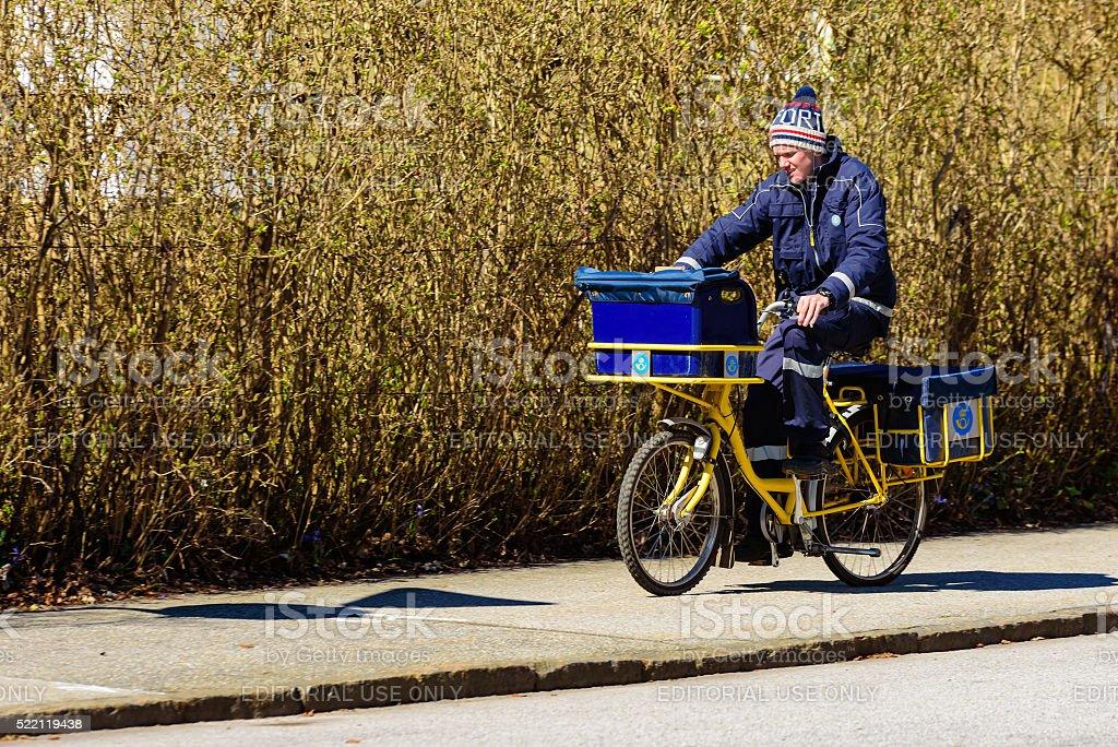 Postman on bike stock photo