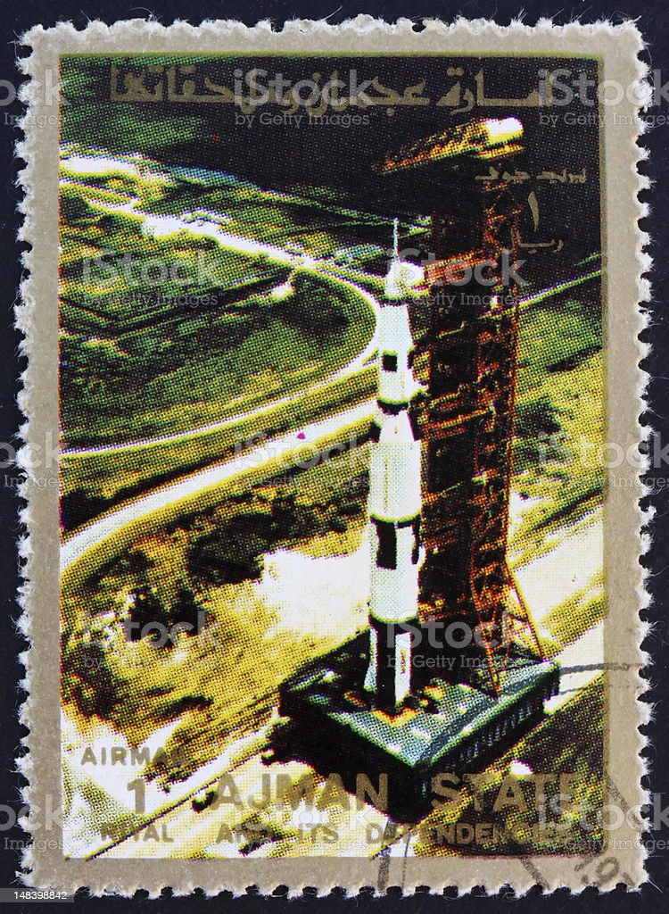 Postmark Ajman 1973 Saturn 5 on launch pad stock photo