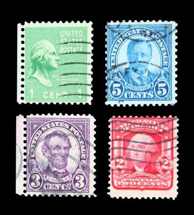 Washington, Lincoln, Roosevelt postmarks isolated on black.